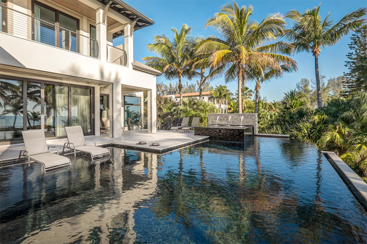 tropical luxury house back patio with large pool