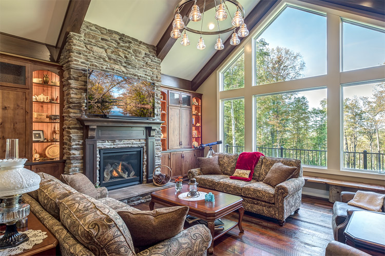 large living room with stone fire place and large windows