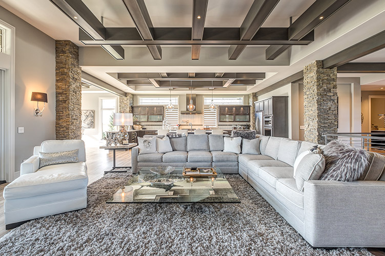 large open space living area with large windows