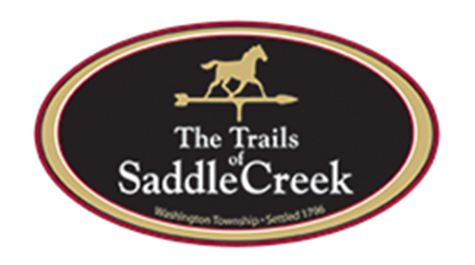 the trails of saddle creek logo